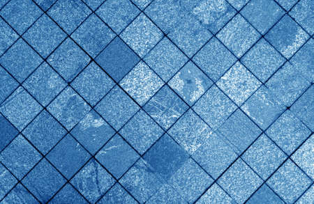 Stone walkway and cobbled road in navy blue tone. Architectural background and texture. 版權商用圖片