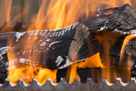 closeup shot of fire wood coil in grill bbq barbecue Фото со стока