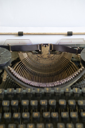 old but gold retro typewriter for old fashioned journalist or reporter. with cyrillic symbols Stock Photo