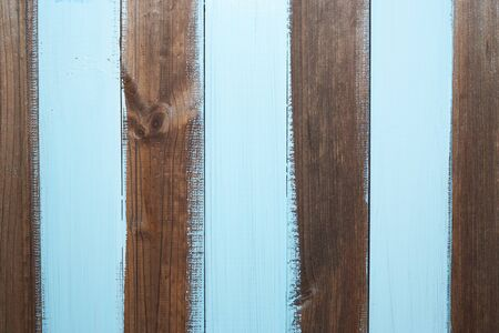 negligent: dark wooden planks with zebra stripped light blue sloppily painting for creative background Stock Photo