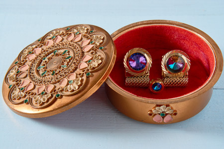small round decorative middle east retro vintage style container with stud cufflinks