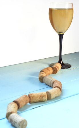 way path to wine glass with white wine made with corks. low angle shot with copy space