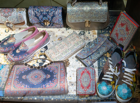 two pairs of handmade skippers and many pouches, purses, handbags in oriental middle east design. Фото со стока