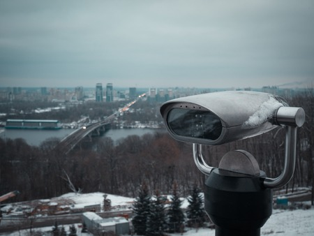 binoculars at city hills for great cityscape scenic view. evening twilight sunset shot made in Kyiv, Ukraine