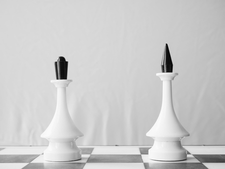 white chessman queen and king apart. couple divorce or distance relations concept