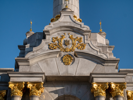 closeup of angel monument with traditional ukrainian symbol tryzub trident at independance square in Kyiv Kiev, Ukraine