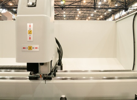 automated industrial programmable laser cutting engraving machine or 3d printer. image inside manufacture facility