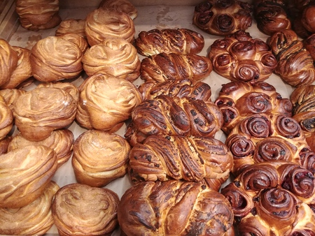 some fancy braided bread at bakery store shop, freashly baked cakes