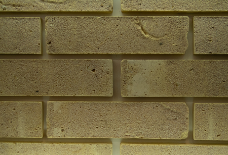 abstract yellow brick wall pattern with artificially aged surface for graphic design, texture, surface print Imagens