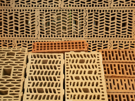 many different types of construction hollow bricks with patterns inside. samples for sale at diy store warehouse depot