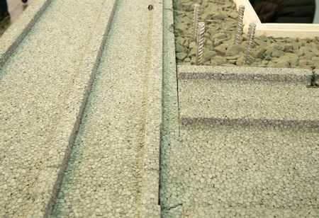 closeup of building wall with insulating  , concrete cement and small stones Imagens - 121240866
