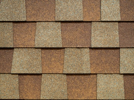 closeup of modern roof trapezoid square shingles tiles. waterproof scabrous rough surface for house exterior cover Imagens