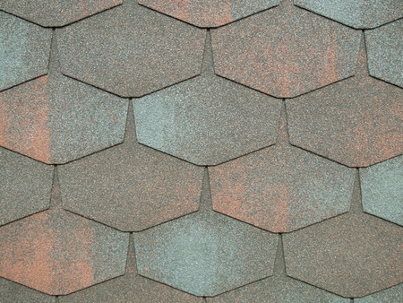 closeup of modern heaxgon roof shingles tiles. waterproof scabrous rough surface for house exterior cover