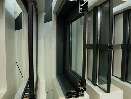 showcase of modern aluminum plastic windows frames in a row. cutted for better inside view