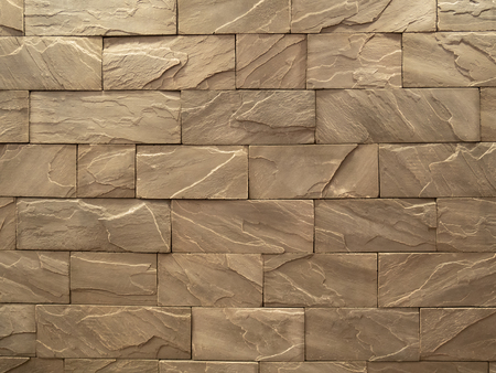 brown rough stone block wall pattern for background Imagens