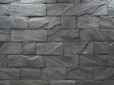 black rough and solid stone block wall pattern for background