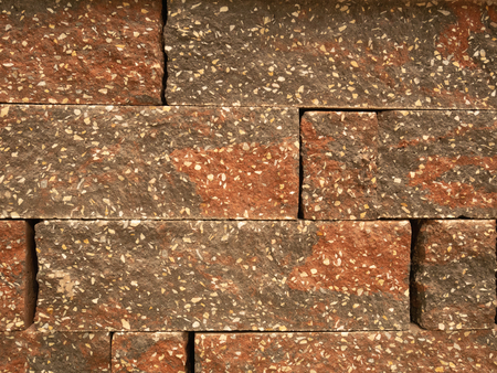 closeup abstract wall pattern red stained bricks with little white blotches Imagens