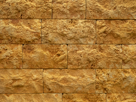 abstract weathered orange and ginger brick wall pattern for background