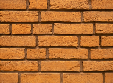 orange brick wall abstract background as design element Imagens