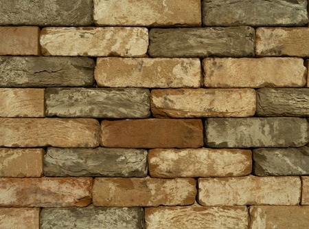 wall of faded vintage bricks. abstract textured background