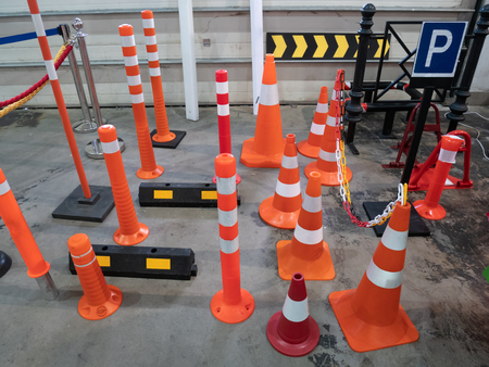 lot of parking traffic cones and limiting driving speed barriers at hardware store 스톡 콘텐츠 - 121186886