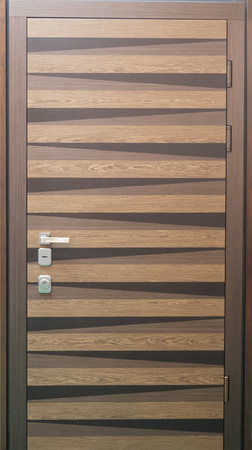 front building entrance front door with stripes in brown color Imagens
