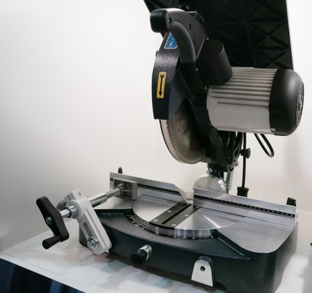 industrial circular saw on table for woodworking or home DIY craft projects