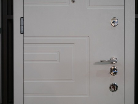 closeup of white entrance modern armored front door with few locks and handle Imagens - 121187049