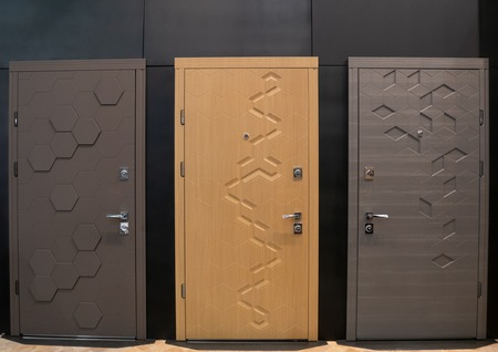 showroom with tree modern entry doors at furniture store Imagens