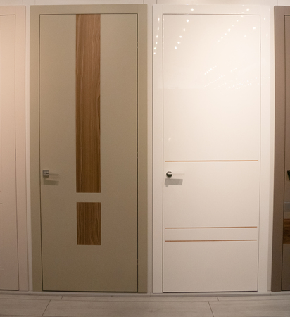 two house room doors for sale at furniture store showroom Imagens - 121187060