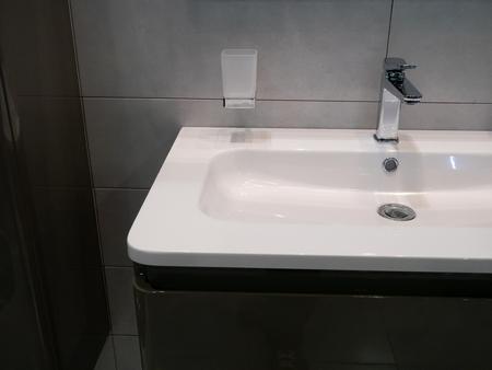 moder washbasin at hotel room in dim light