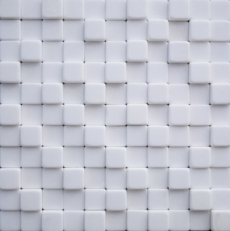 abstract wallpaper or background made of white marble stone cubes Imagens - 121187230