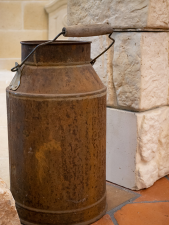 closeup old vintage rusty milk can tank at farm Imagens