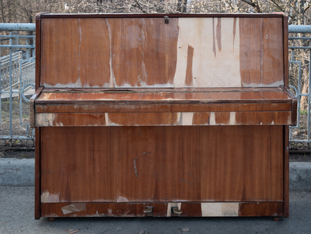 old weathered closed piano at city park open air