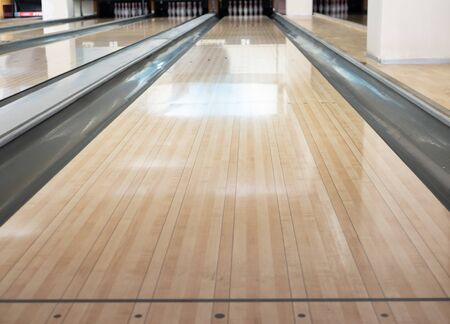 close-up of one empty bowling track lane at entertainment center Imagens