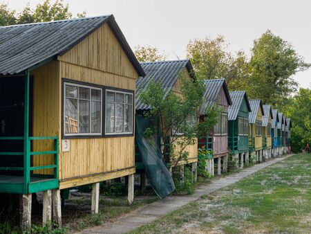 countryside quiet peaceful place for recreation and day off. row of small multi colored wooden houses in the forest
