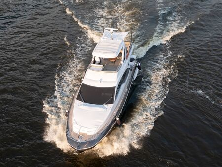 drone aerial close-up shot of luxury white yacht motorized boat sailing at mediterranean sea. premium travel concept
