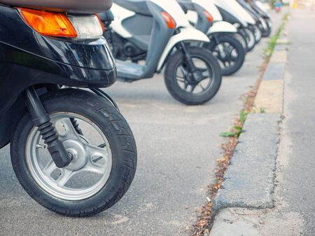 row of small motobikes for sale or rent. selective focus on foreground with shallow depth of field . Stock fotó