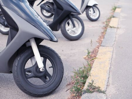 few motobikes on parking near motorcycle store market or rental service. only wheels visible. fast and easy delivery . Imagens