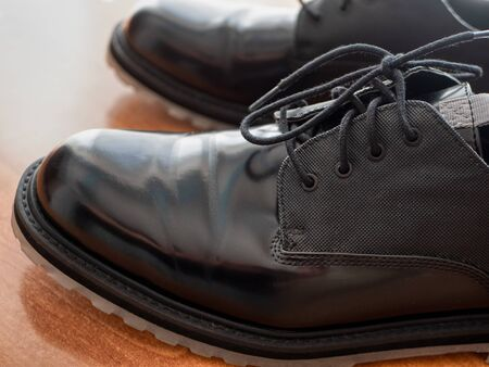 closeup of man black glossy formal shoes, profile view with shoelaces