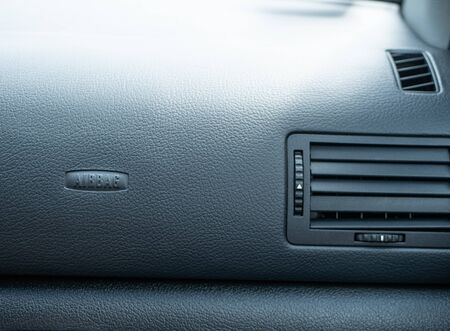 dashboard panel inside car with airbag sign. safety and vehicle insurance concept