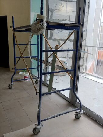 small portable scaffolding at construction site. wide image Imagens