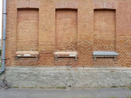 building wall with few bricked windows frames. first floor of old building Imagens