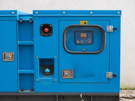 industrial diesel power generator electrical equipment. close-up of control panel with display and buttons. Imagens