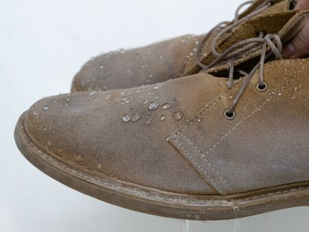 water drops on waterproof suede desert boots shoes after use weatherproof spray, apparel care equipment