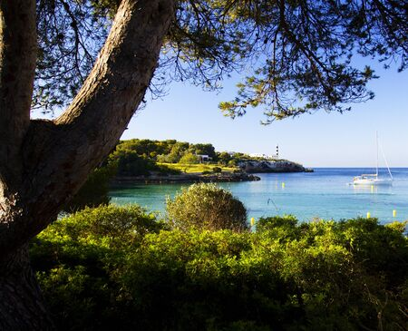 The bay and the lighthouse in Porto Colom.
