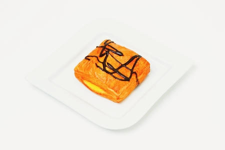 Dessert on white plate and background.