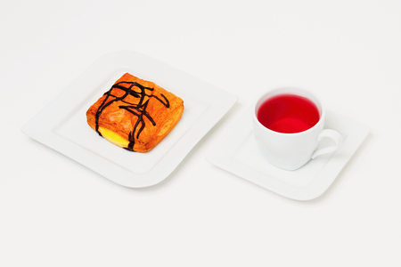 Dessert and tea on white plate and background.