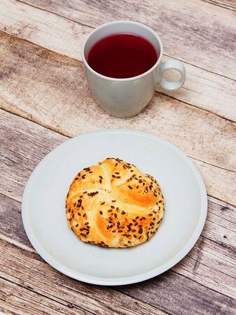 Tea and kaiserka on a plate.