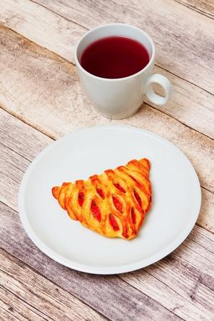 Tea and cake on white plate.